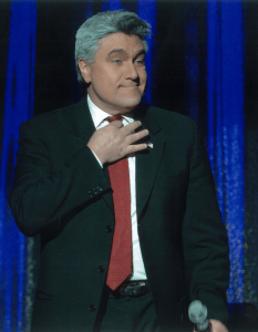 Marcel Forestieri as Jay Leno on stage