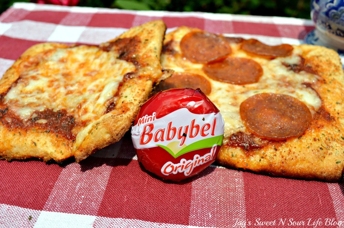 Mini Babybel Pizza Recipe. Bake up some kid-friendly mini babybel pizzas. They are pefect for quick weeknight dinners or easy to make weekend meals.