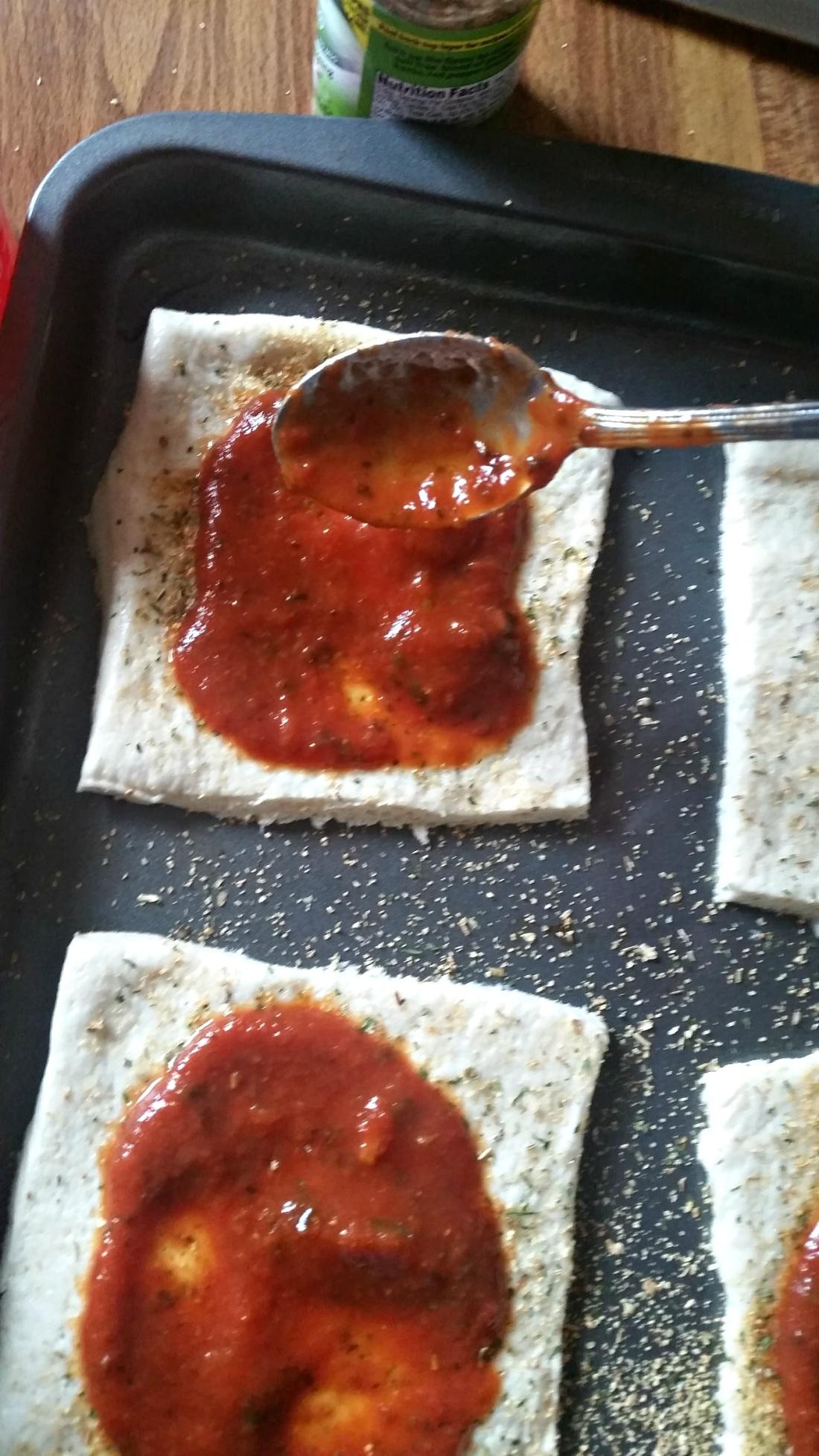 mini babybel pizzas crust with sauce. Bake up some kid-friendly mini babybel pizzas. They are perfect for quick weeknight dinners or easy to make weekend meals.