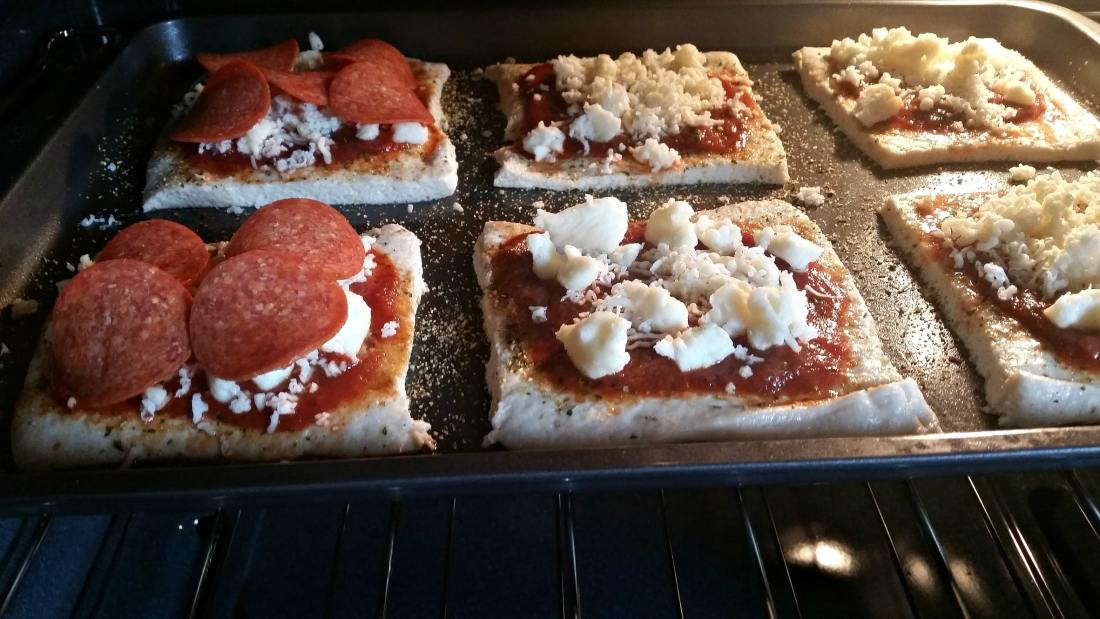 mini babybel pizzas in the oven. Bake up some kid-friendly mini babybel pizzas. They are perfect for quick weeknight dinners or easy to make weekend meals.