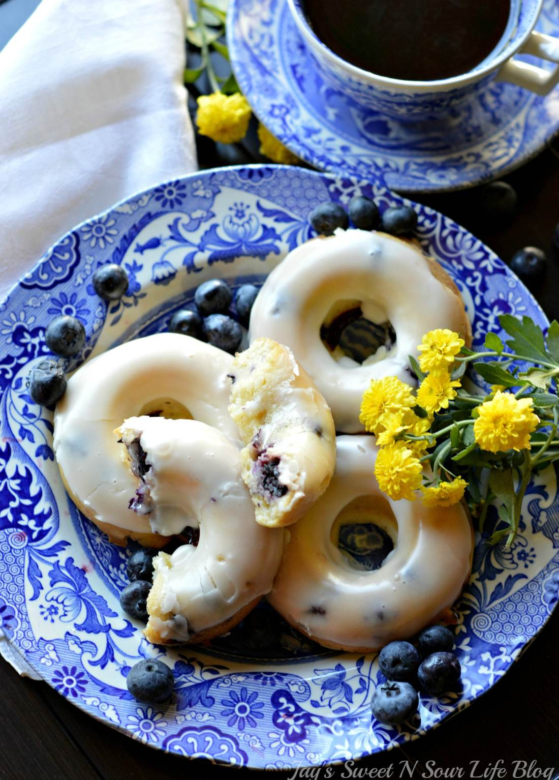 Banana Blueberry Donuts Overhead Shot. This light and tasty Banana Blueberry Baked Donuts recipe is made with fresh blueberries and ripe banana's. Try my yeast free donut recipe today.