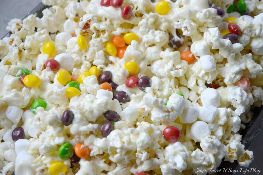 Game Day Skittles Inspired Snacks popcorn step 11. Game Day Skittles Inspired Snacks that all of your friends and family can enjoy! Recipes include skittles popcorn, football cupcakes and more!