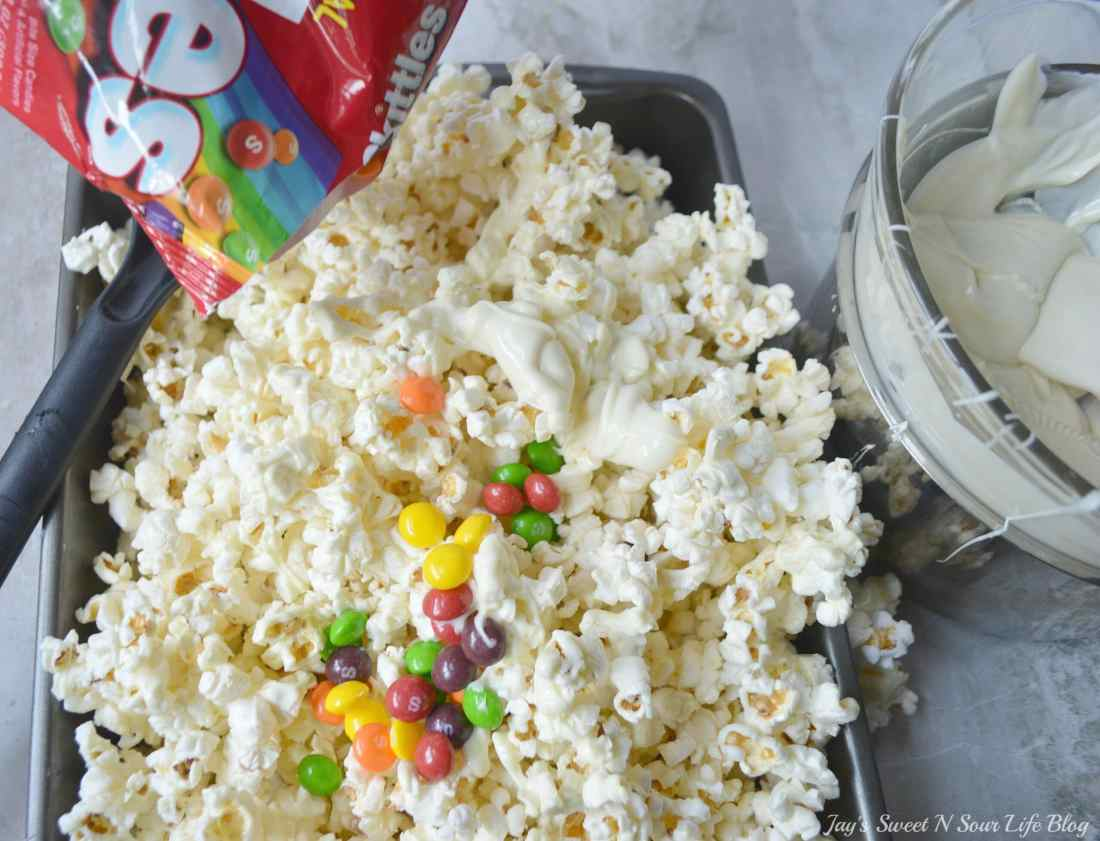 Game Day Skittles Inspired Snacks popcorn step 8. Game Day Skittles Inspired Snacks that all of your friends and family can enjoy! Recipes include skittles popcorn, football cupcakes and more!