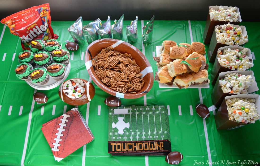 Game Day Skittles Inspired Snacks Overhead Table Spread 1. Game Day Skittles Inspired Snacks that all of your friends and family can enjoy! Recipes include skittles popcorn, football cupcakes and more!