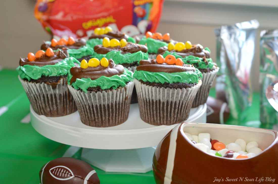 Game Day Skittles Inspired Snacks Table Toppers Cupcakes. Game Day Skittles Inspired Snacks that all of your friends and family can enjoy! Recipes include skittles popcorn, football cupcakes and more!