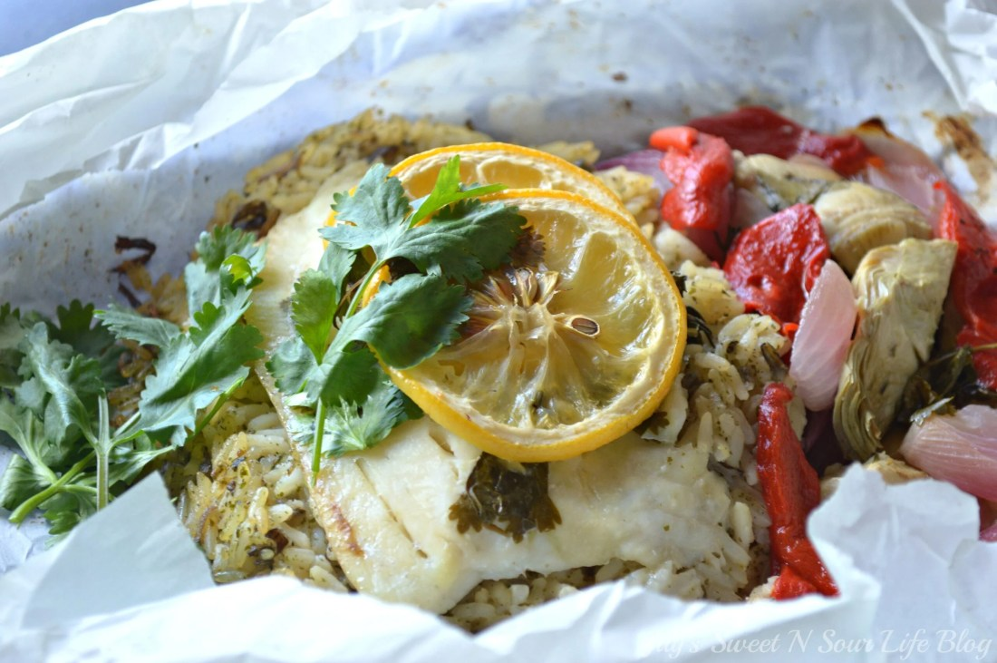 Lemon Roasted Tilapia and Vegetables Closeup. Dinner for two has never been so easy and delicious. This Fresh Lemon Roasted Tilapia and Vegetables are full of fresh flavor and spices.