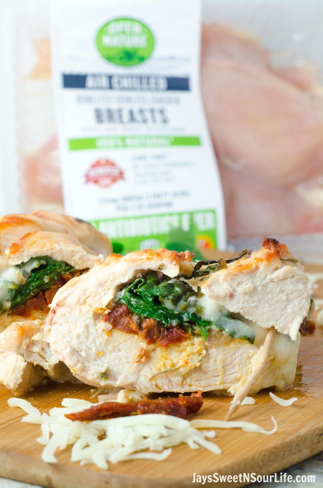 Sundried Tomato, Spinach and Cheese Stuffed Chicken Side View of Ingredients. Made with Open Nature® Air Chilled Chicken, available exclusively in Safeway.