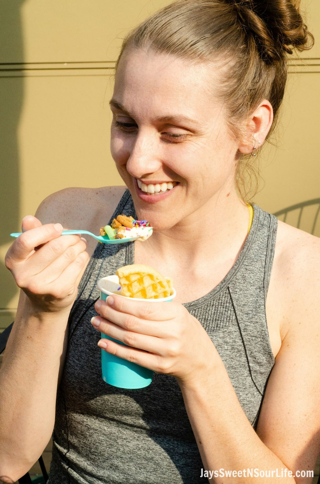 Woman enjoying a sundae at a Beach Sundae Party with friends and family.