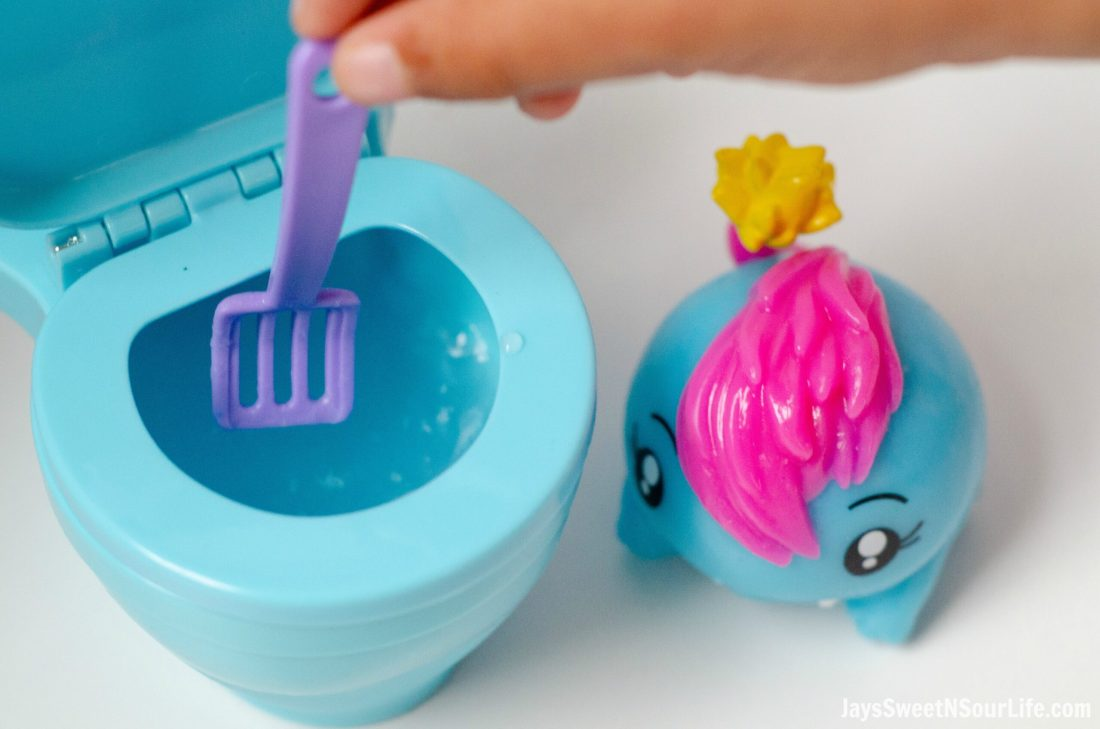 Pooparoos Toy With Scooper in Toilet. Pooparoos are full of fun surprises and tons of fun for all.