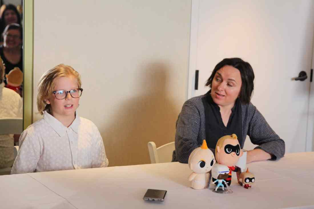 Incredibles 2 Interview with Sarah Vowell & Huck Milner both speaking at table. Voice actors of Dash and Violet Parr Tell All in this revealing exclusive interview.
