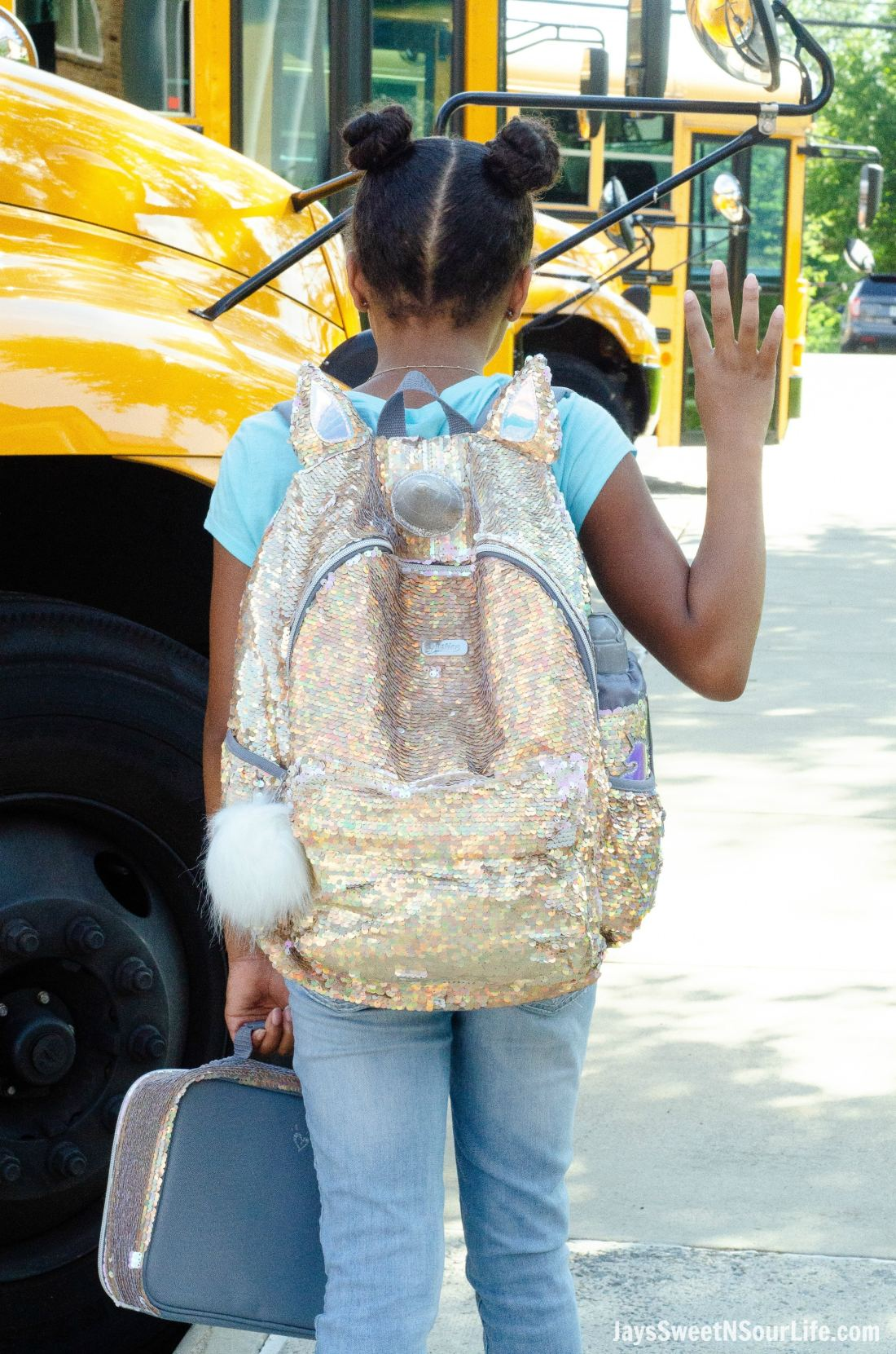 Justice Back To School Unicorn Backpack Lifestyle Shot Infront of Bus.Back To School Must Have Fashion For Tweens via JaysSweetNSourLife.com