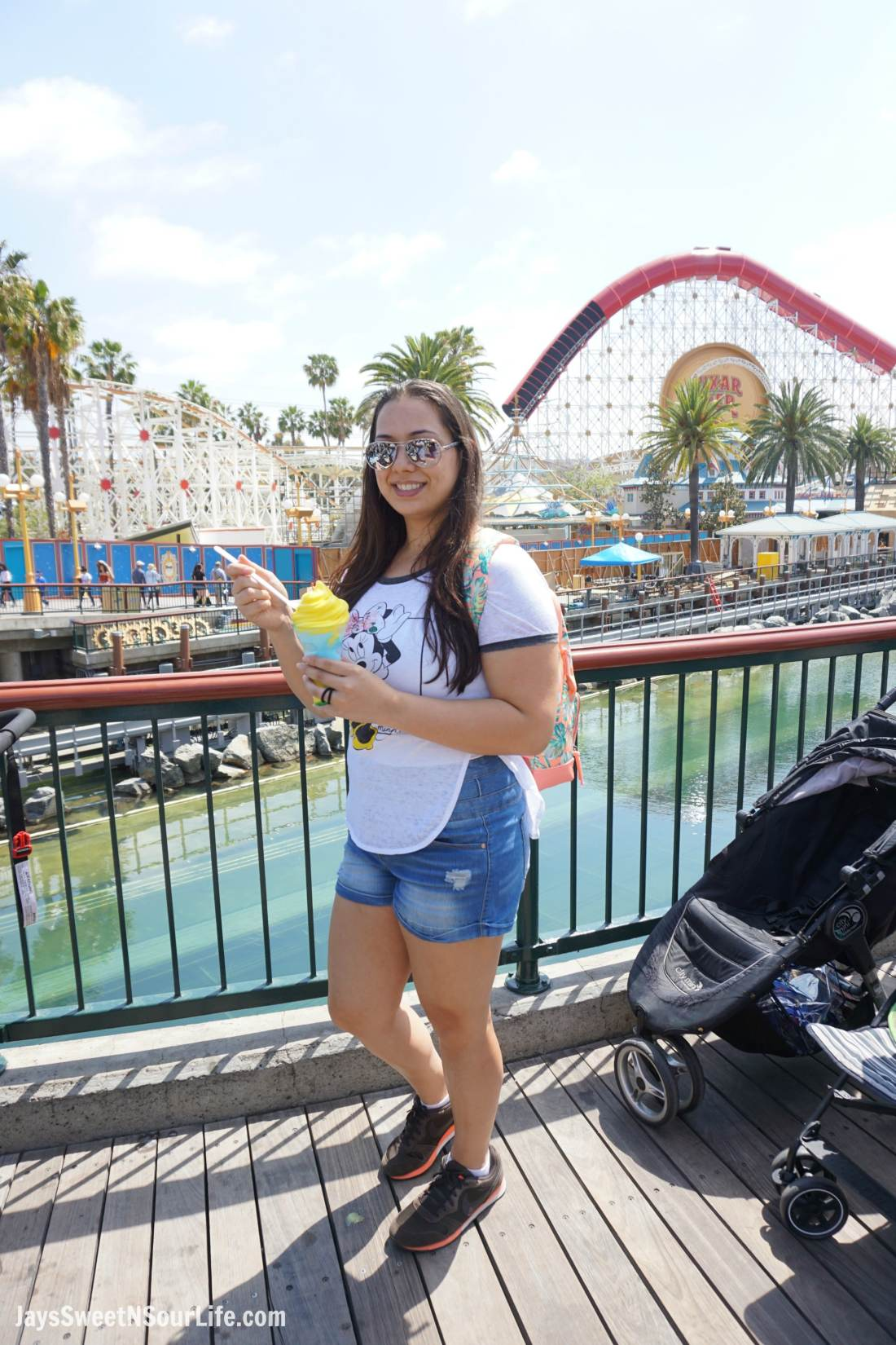 Pixar Pier at Disneyland Filipino Woman Eating Pixar Pier Frosty Parfait. Pixar Fest at Disneyland runs from April 13 through September 3rd.