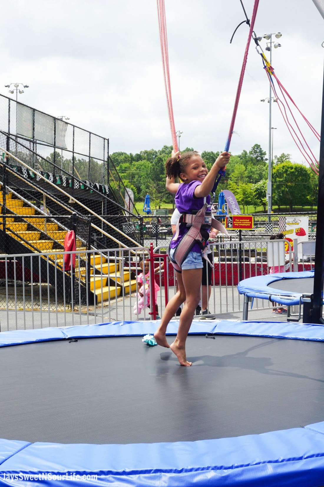 SpeedPark - Visit Cabarrus County Track Bungee Jumping Girl. A Large Families Adventure Guide To Cabarrus County - North Carolina - via JaysSweetNSourLife.com.