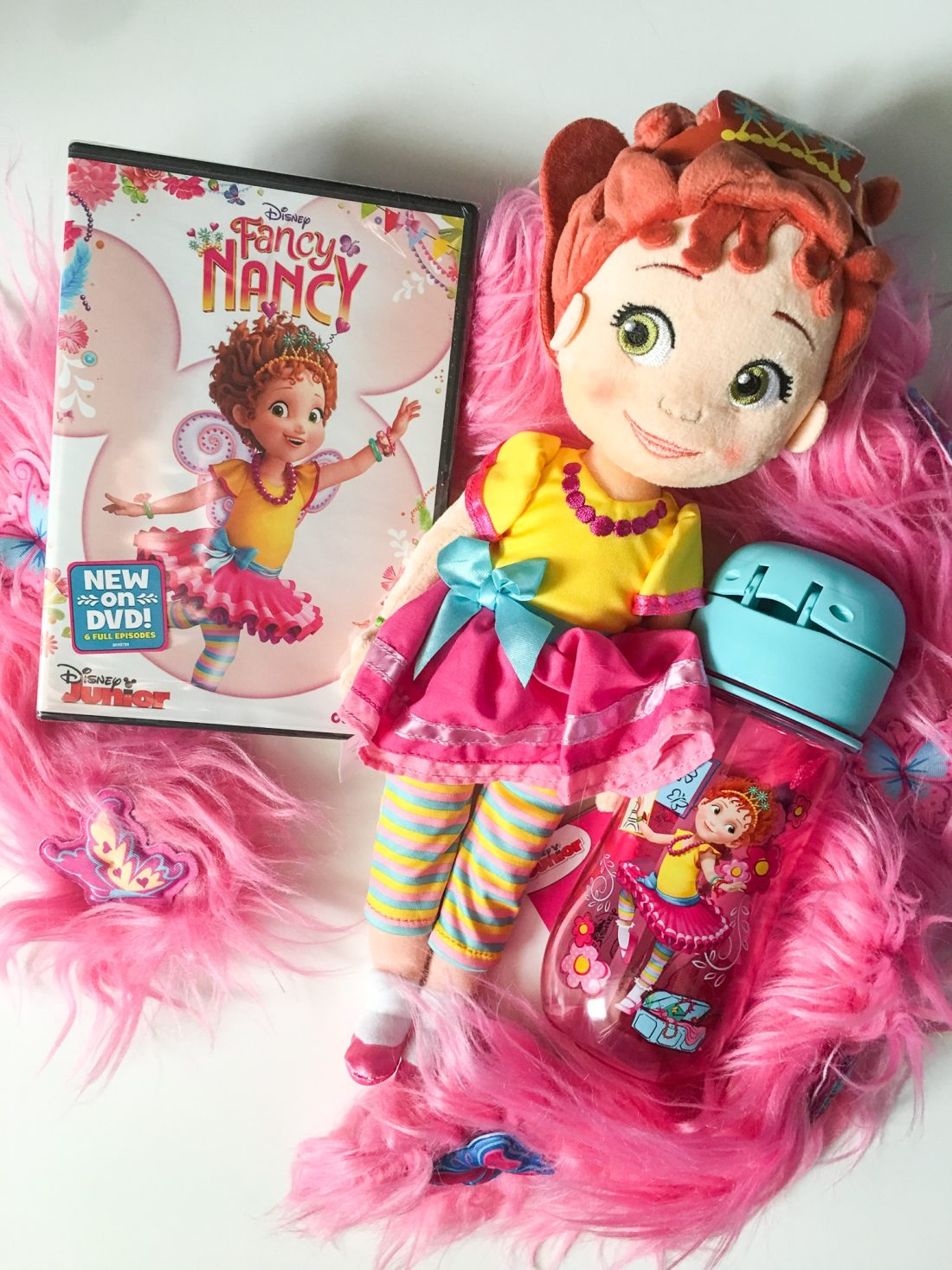 "Fancy Nancy DVD Plush Toy and Canteen. Grab some glitter, add a dash of ""ooh la la,"" sprinkle in original songs and Voilà! Get set to pour on the fun with Fancy Nancy in her newest DVD from Disney Junior."