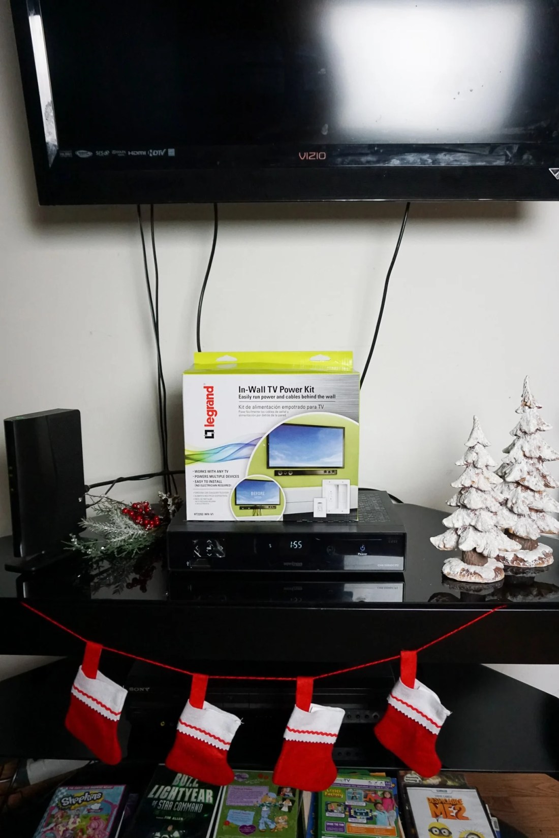 Legrand - In-Wall TV Power Kit On TV Stand On Display. Hide those ugly TV Cables with the Legrand - In-Wall TV Power Kit, read the full review..