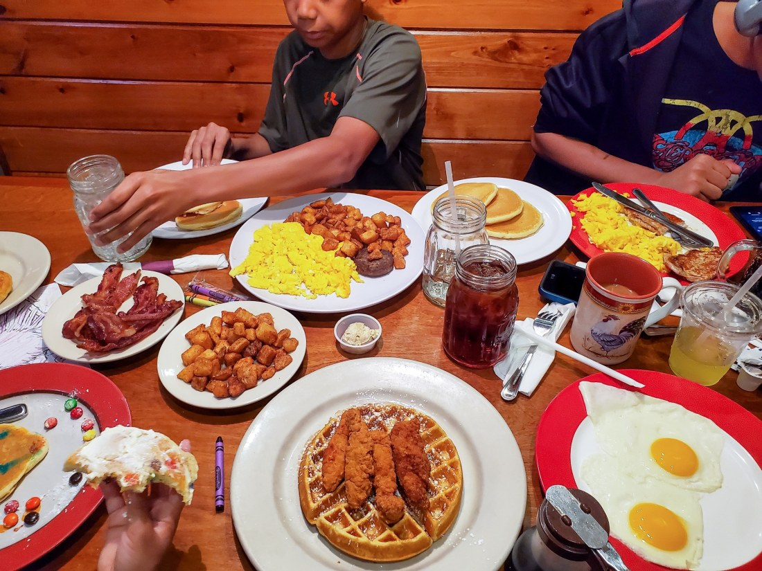 Sawyers Farmhouse Breakfast Table Spread. One of the best farmhouse style breakfasts in town is at Sawyers Farmhouse located in Pigeon Forge, TN. Serving a variety of Breakfast foods including Crepes, Belgium Waffles, Made from Scratch Pancakes, syrups and compotes.