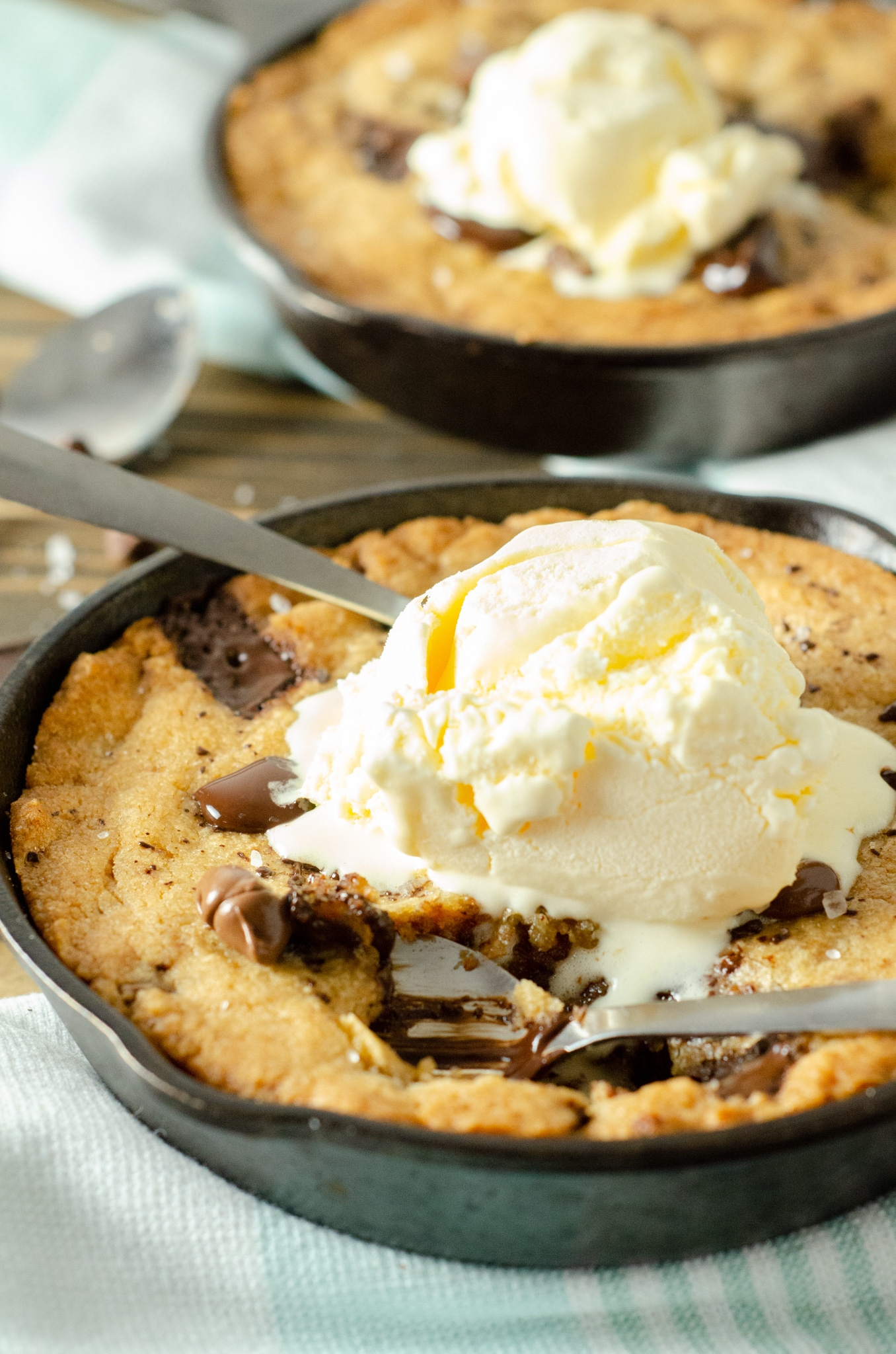 Chocolate Chip Skillet Cookie Ice Cream. This brown butter Chocolate Chip Skillet Cookie is packed with chunks of chocolate and topped with sea salt, it's the perfect dessert for two. The insanely soft center and crispy buttery edges will have you falling in love with this easy pizookie recipe.