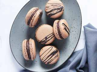 Chocolate Macarons with Salted Caramel Filling Plated.These Chocolate Macarons with Salted Caramel Filling are a delight, so soft and full of flavor. Perfect for entertaining as well as sweet treat gifts to loved ones during the holidays.