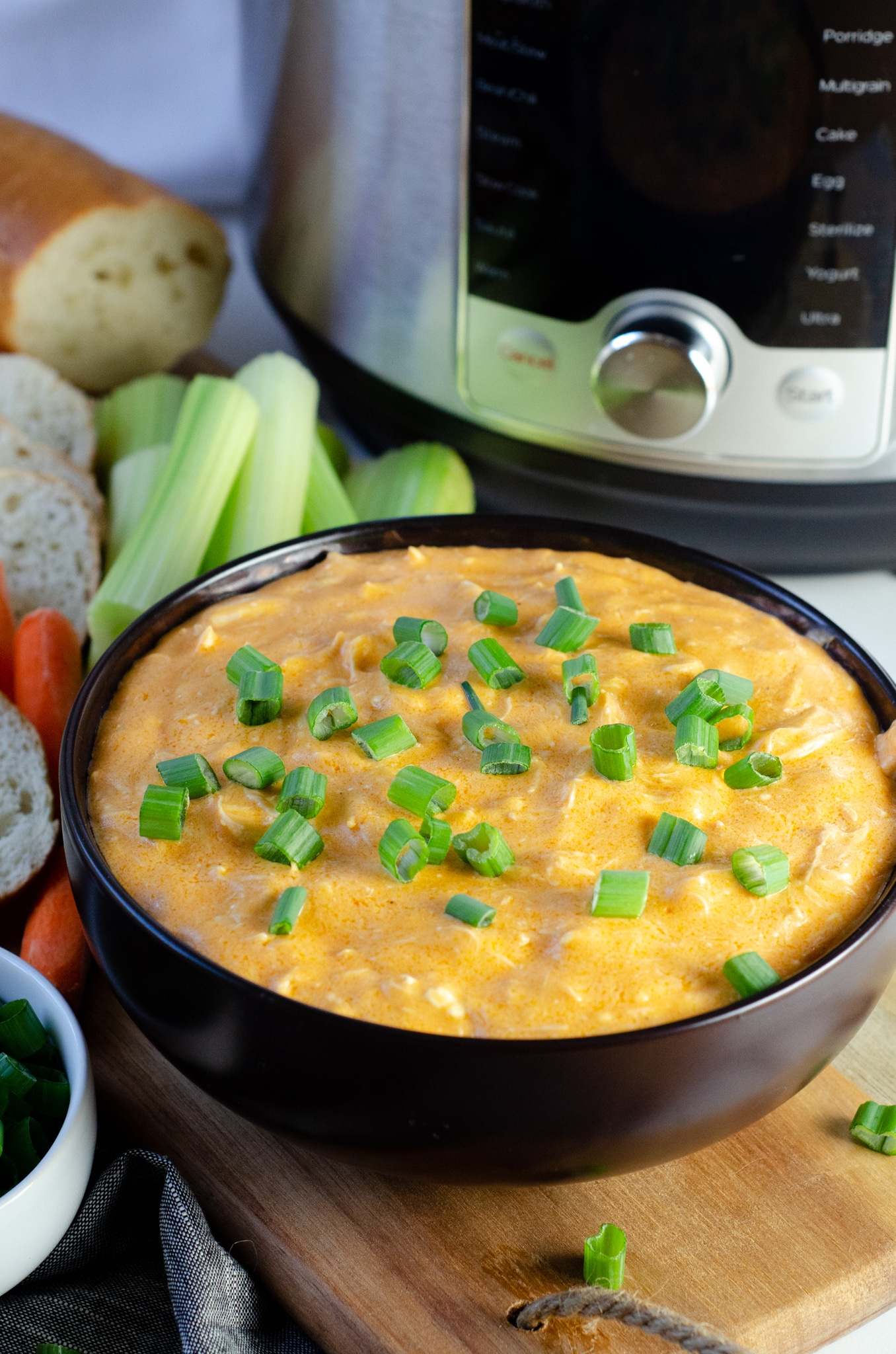 Buffalo Chicken Dip Instant Pot. This easy one-pot Buffalo Chicken Dip recipe is packed full of flavor and oh so easy to make. It's a foolproof appetizer recipe that easily becomes the star of any party and can be made in the Instant Pot or Slow Cooker.