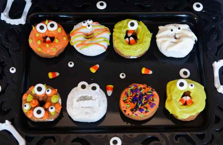 Halloween Monster Donuts Group. Make these spooky cute Monster Donuts for your next Halloween event. Made with your favorite donuts as a base, you can create and decorate vampires, mummies, and other iconic edible Halloween monsters.