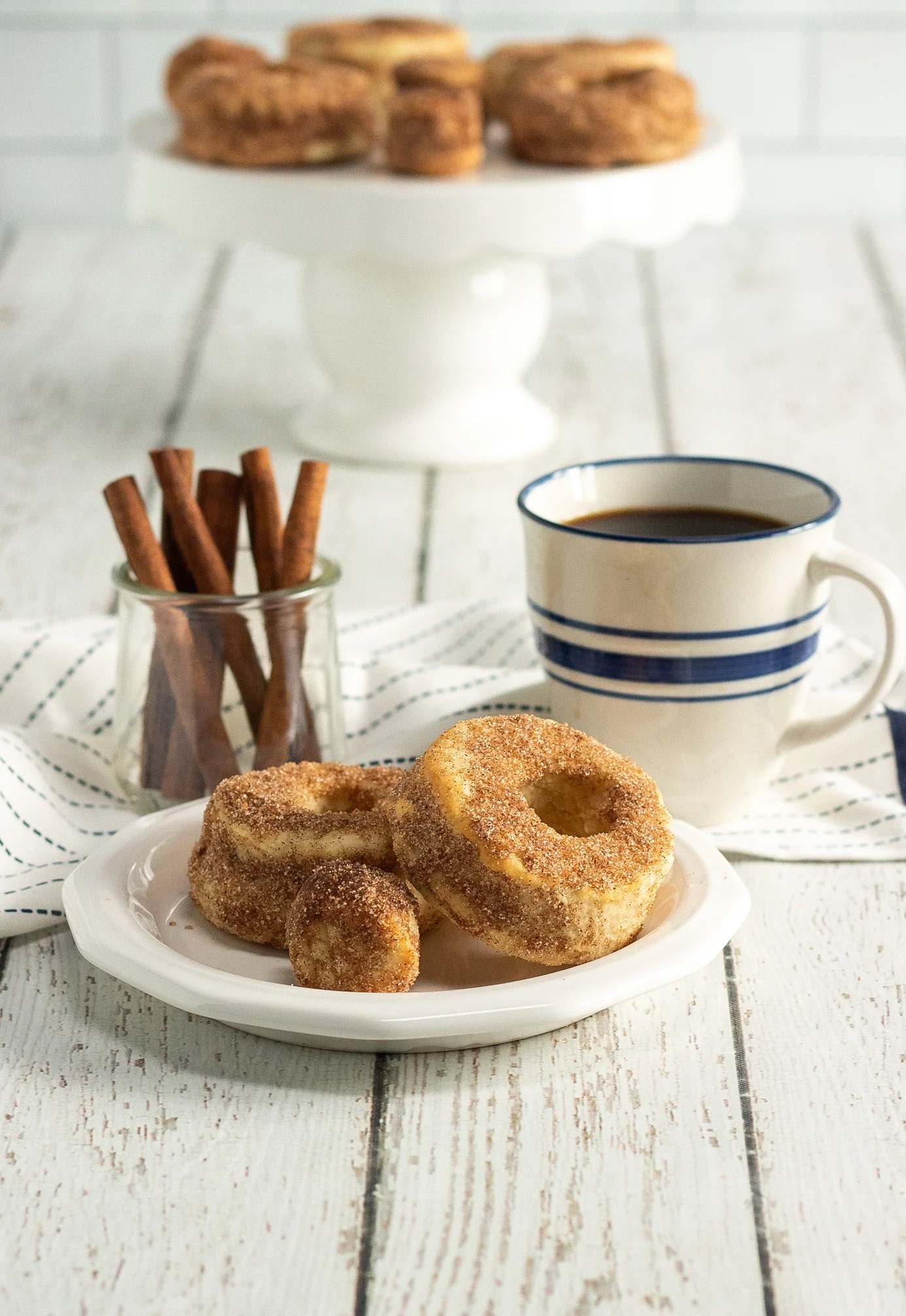 Air Fyrer Pumpkin Spice Donuts Table. Fill your home with the smell of freshly made Air Fryer Pumpkin Spice Donuts, perfect for this beautiful fall weather we are having. These easy to make Pumpkin Spice Donuts have a crisp outer coating yet they so soft fluffy inside, enjoy them with a healthy coating of cinnamon sugar, or your favorite glaze.