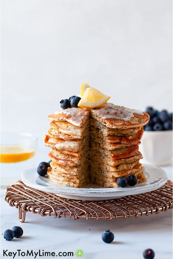 These easy and fluffy gluten-free lemon poppy seed pancakes make the perfect Christmas morning pancakes! Try serving these pancakes with lemon glaze!
