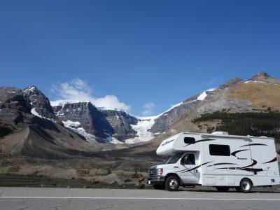 RV driving through the mountains.
