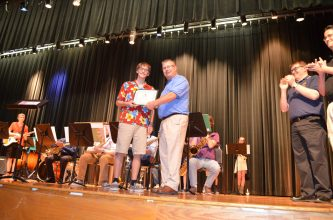 Austin Miller receives scholarship from Junior Warden Dave Olmstead