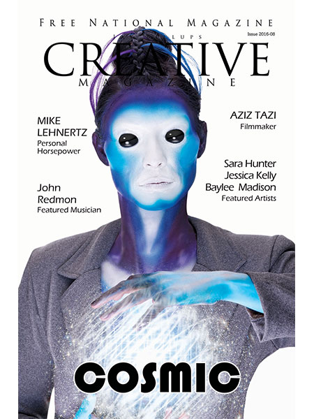 Magazine cover. Alien with blue skin and black eyes holding a ball of light and energy