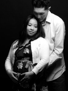 Black and white maternity photo with young Asian couple
