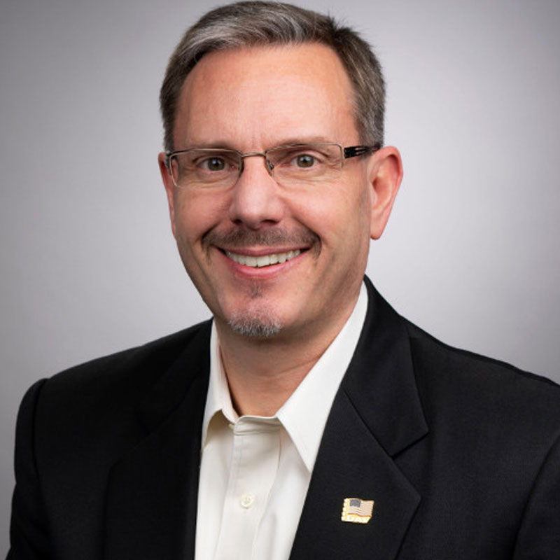 Headshot, chest up, of a local financial advisor in Colorado Springs