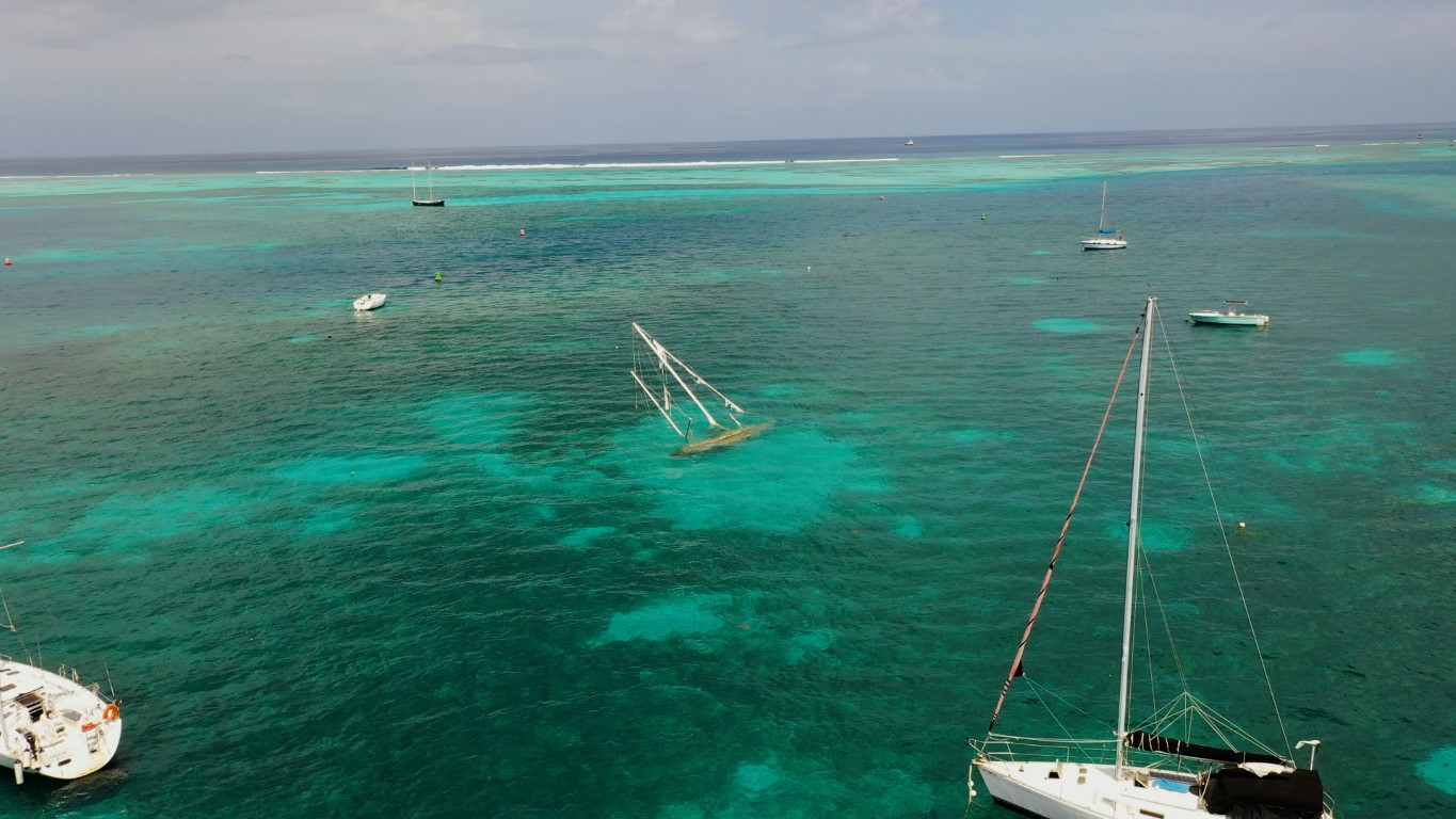 Aerial video of sunken sailboat in the St Croix Harbor USVI on a slightly overcast day, but crystal clear waters