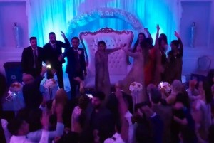 indoor drone footage of dancing at a Pakistani Wedding