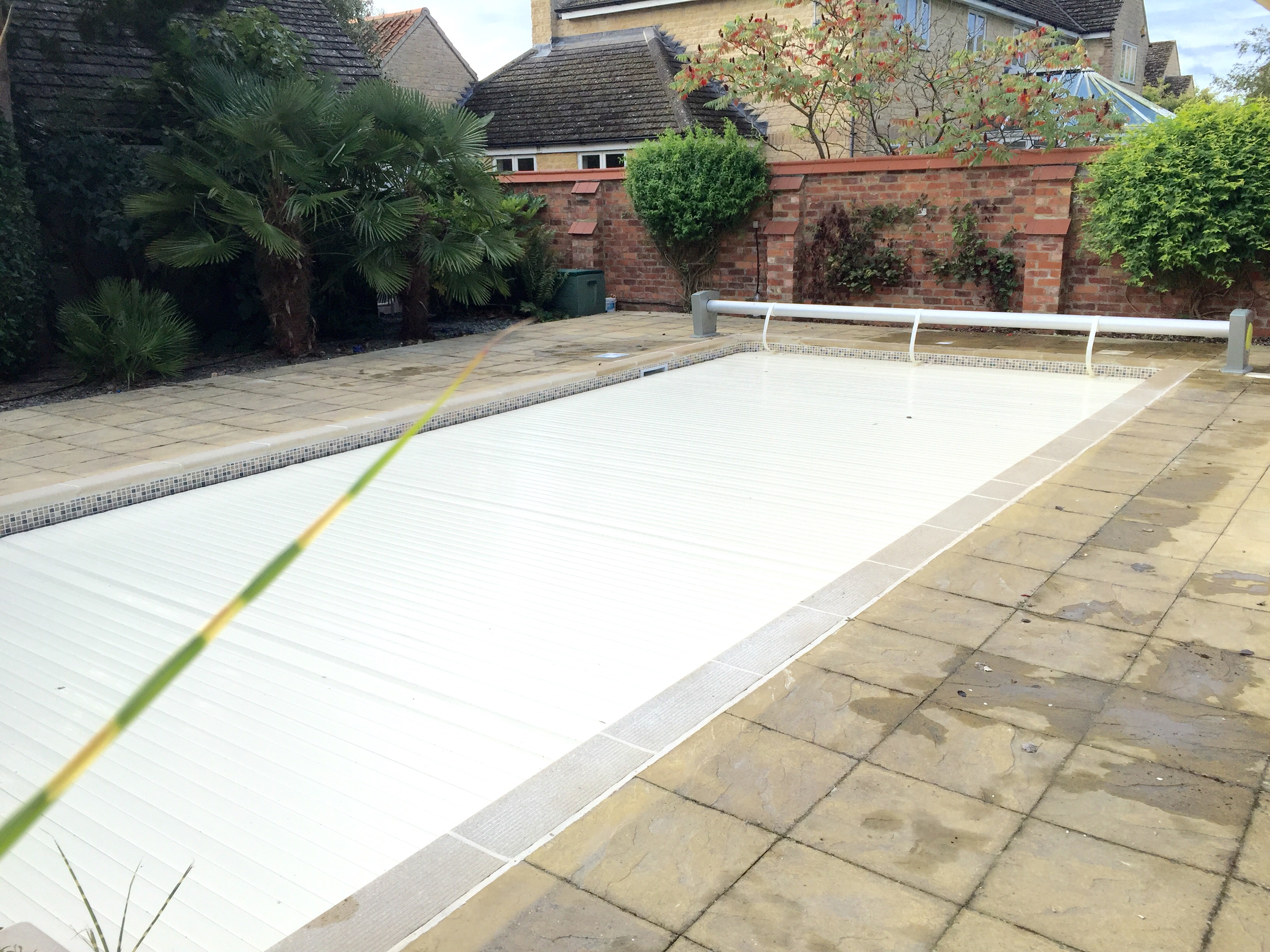 Pool with slatted cover on