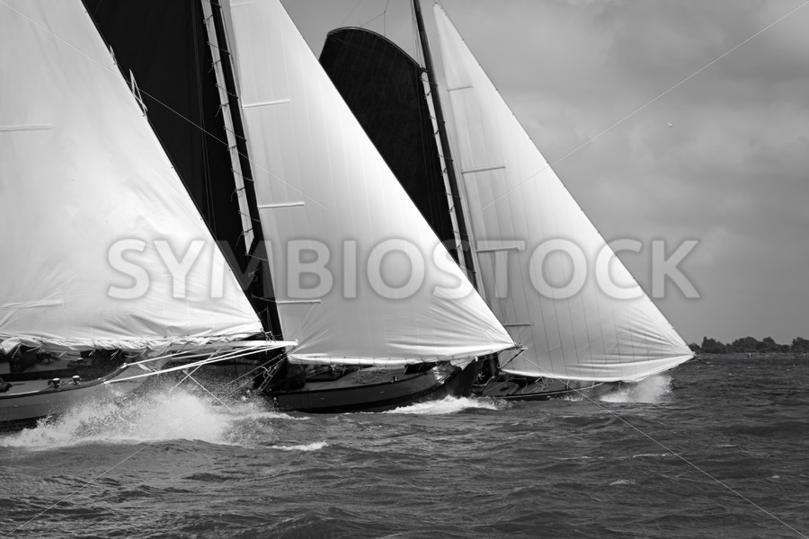 Skutsjes sailing vessels in the midst of a regatta - Jan Brons Stock Images