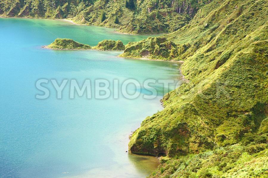 Blue crater lake ocean island - Jan Brons Stock Images