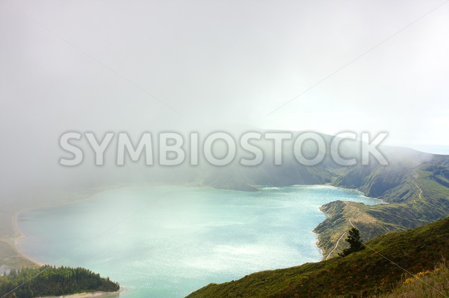 Crater lake in clouds - Jan Brons Stock Images