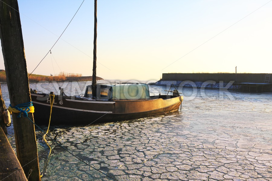 Fishing Ship in Harbour - Jan Brons Stock Images