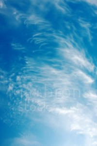 Strong winds forming cirrus clouds with a deep blue sky
