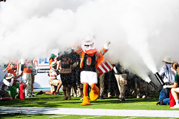 Sebastian the Ibis walks the team out through the smoke