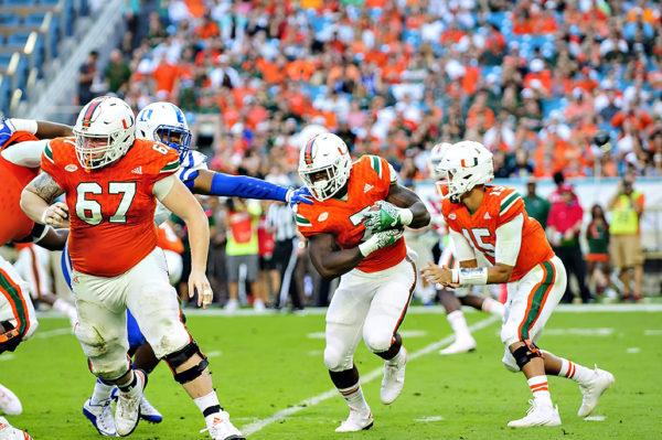 Hurricanes RB, Gus Edwards, rushes against Duke