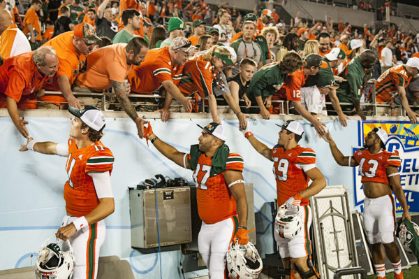 Miami Hurricane players thank the fans for all their support