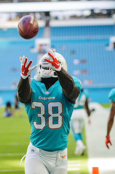 Dolphins RB #38, De'Veon Smith, looks to haul in a catch during warm ups