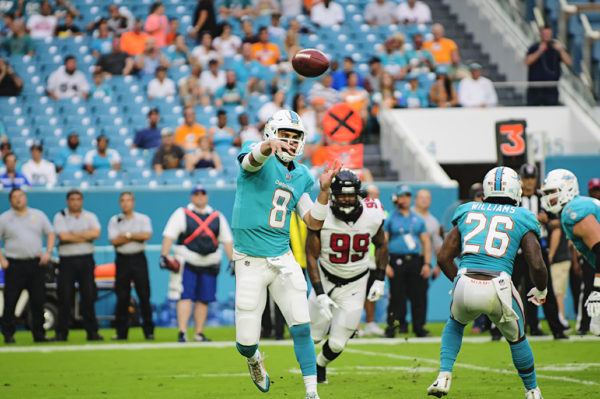 Dolphins QB, #8 Matt Moore, throws a pass during a game against the Atlanta Falcons