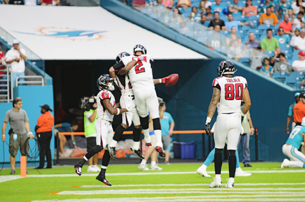 Matt Ryan and Devonta Freeman celebrate Freeman's touchdown run in the 1st quarter against the Dolphins