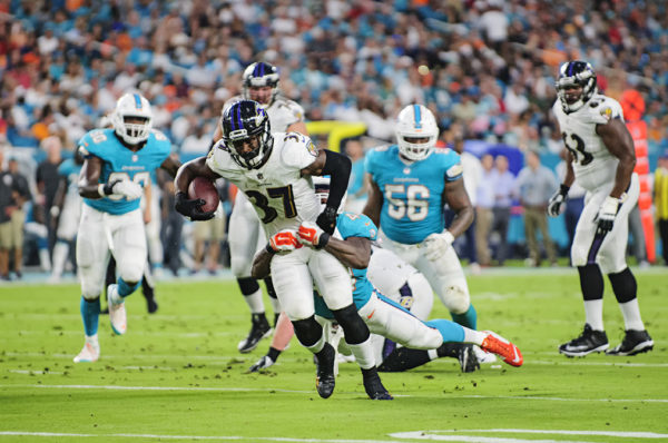 Ravens RB #37, Javorius Allen, tries to break free from a tackle