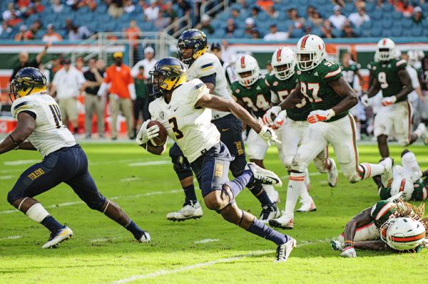 Diontae Johnson, Toledo RB, runs past Hurricane Defenders