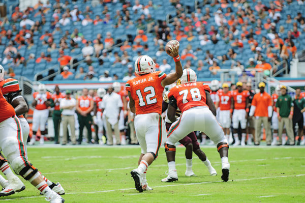 Hurricanes QB, Malik Rosier, throws a pass against Bethune-Cookman