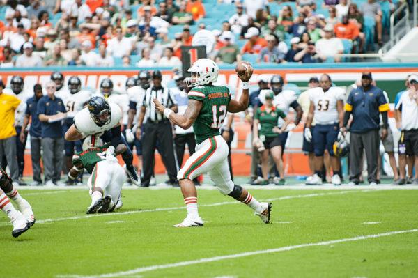 Hurricanes QB, Malik Rosier, attempts a pass against Toledo