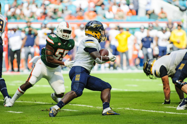 Terry Swanson, Toledo RB, tries to find an opening to run through
